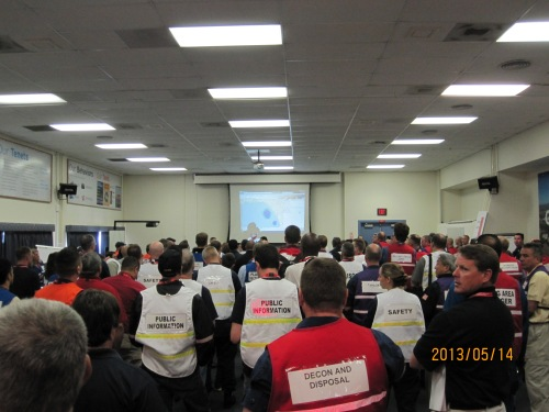 The morning briefing of the oil spill exercise, showing the initial spill using ERMA, a GIS response tool.  http://response.restoration.noaa.gov/maps-and-spatial-data/environmental-response-management-application-erma.  If a major oil spill occurs off our coast, various industry and government professionals would work together using the Incident Command Structure.  At the exercise, responders wear vests to label their position within ICS.  http://www.fema.gov/incident-command-system.